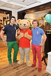 Sharky & George and the RL Gang hosted a pre-Easter Holiday party in support of CLIC Sargent at the Ralph Lauren Children's store, 139/141 Fulham Road, London SW3 on 23rd March 2011.<br /> Image shows:- Left to right, children's entertainers CHARLIE ASTOR and GEORGE WHITEFIELD - Sharky & George, with the Ralph Lauren Bear.