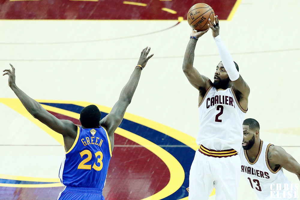 07 June 2017: Cleveland Cavaliers guard Kyrie Irving (2) takes a jump shot over Golden State Warriors forward Draymond Green (23) during the Golden State Warriors 118-113 victory over the Cleveland Cavaliers, in game 3 of the 2017 NBA Finals, at  the Quicken Loans Arena, Cleveland, Ohio, USA.