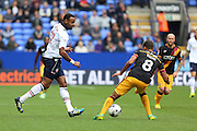 Bolton Wanderers midfielder Liam Trotter (17) plays the ball past Bradford City midfielder Timothee Dieng (8) during the EFL Sky Bet League 1 match between Bolton Wanderers and Bradford City at the Macron Stadium, Bolton, England on 24 September 2016. Photo by Simon Brady.