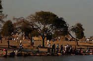 Fishermen and locals interact in the shores of the Blue Nile in the town of Joseph Kore Village, just 20 kilometers outside of Malakal city in Upper State and last area of control of the South Sudan government.   (PHOTO: MIGUEL JUAREZ LUGO).