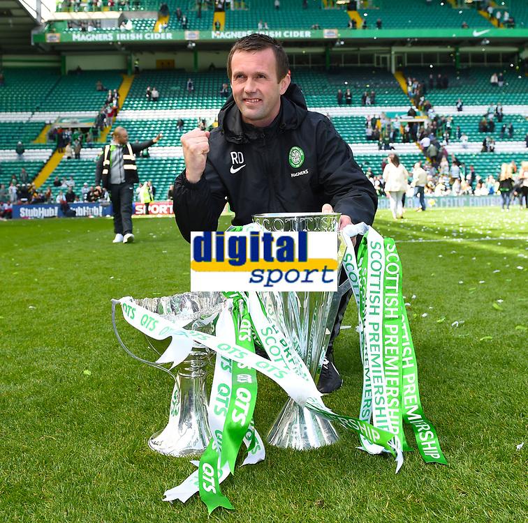 24/05/15 SCOTTISH PREMIERSHIP<br /> CELTIC v INVERNESS CT<br /> CELTIC PARK - GLASGOW<br /> Celtic manager Ronny Deila celebrates with the Scottish League Cup and the Scottish Premiership trophy<br /> ** ROTA IMAGE - FREE FOR USE **