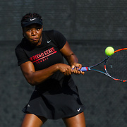 10 November 2017:  The San Diego State Aztecs women's tennis team hosts it's annual Fall Classic II. Nnena Nadozie seen here retiring a serve during a doubles match.<br /> www.sdsuaztecphotos.com