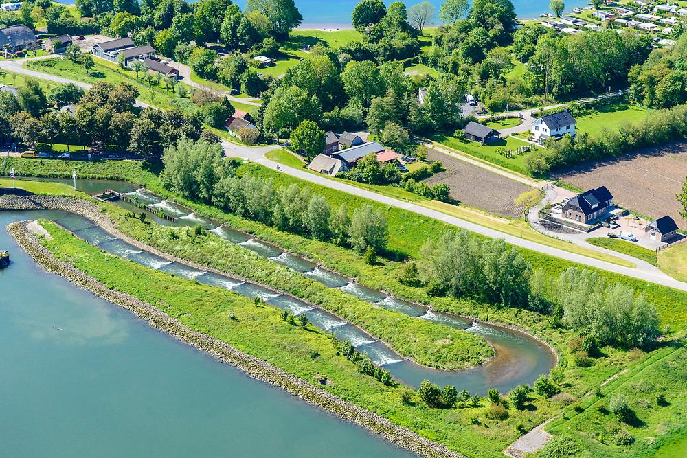 Nederland, Utrecht, Hagestein, 13-05-2019; stuw in de rivier de Lek, dient om het waterpeil in de rivier te reguleren en het scheepvaartverkeer mogelijk te maken. <br /> Naast de stuw de vispassage:  vissen kunnen gebruik maken van de de vistrap om de stuw te passeren.<br /> Weir in the river Lek, regulates and manages the water level. The Lek is a rain river, with especially in the winter large amounts of water (melt water), in the summer there is a shortage of water, the weir ensures sufficiently high water level for shipping. Next to the dam fish ladder.<br /> luchtfoto (toeslag op standard tarieven);<br /> aerial photo (additional fee required);<br /> copyright foto/photo Siebe Swart
