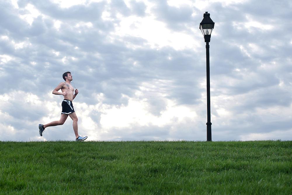 Tom Liauba goes for a spring run on the bike path. Photo by Ross Brinkerhoff.