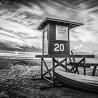 Newport Beach Lifeguard Tower 20 Black and White HDR Photo during sunrise on Balboa Peninsula beach in Newport Beach California.  Newport Beach is  located in Orange County in Southern California along the Pacific Ocean. Image Copyright © Paul Velgos All Rights Reserved.