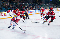 KAMLOOPS, CANADA - NOVEMBER 5:  Veniamin Baranov #19 of Team Russia skates with the puck while backchecked by Kirby Dach #77 and Jordy Bellerive #15 of Team WHL on November 5, 2018 at Sandman Centre in Kamloops, British Columbia, Canada.  (Photo by Marissa Baecker/Shoot the Breeze)