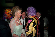 PRINCESS MICHAEL OF KENT; RICHARD CARING; BARRY HUMPHRIES, The Ormeley dinner in aid of the Ecology Trust and the Aspinall Foundation. Ormeley Lodge. Richmond. London. 29 April 2009