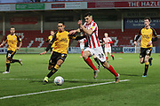 Kyle Knoyle and Jacob Greaves   during the EFL Sky Bet League 2 match between Cheltenham Town and Cambridge United at Jonny Rocks Stadium, Cheltenham, England on 14 December 2019.