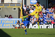AFC Wimbledon defender George Francomb (7) clearing the ball from Bristol Rovers striker Byron Moore (22) during the EFL Sky Bet League 1 match between AFC Wimbledon and Bristol Rovers at the Cherry Red Records Stadium, Kingston, England on 8 April 2017. Photo by Matthew Redman.