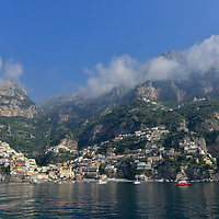 The village of Positano surrounded by hills and mountains of the Amalfi Coast in southern Italy.
