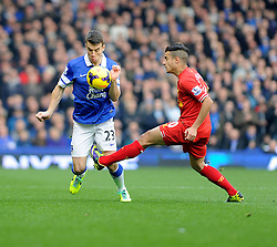 Everton's Seamus Coleman is challenged by Liverpool's Philippe Coutinho - Photo mandatory by-line: Dougie Allward/JMP - Tel: Mobile: 07966 386802 23/11/2013 - SPORT - Football - Liverpool - Merseyside derby - Goodison Park - Everton v Liverpool - Barclays Premier League