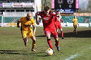 James Collins of Crawley Town and David Pipe of Newport County during the EFL Sky Bet League 2 match between Newport County and Crawley Town at Rodney Parade, Newport, Wales on 1 April 2017. Photo by Andrew Lewis.