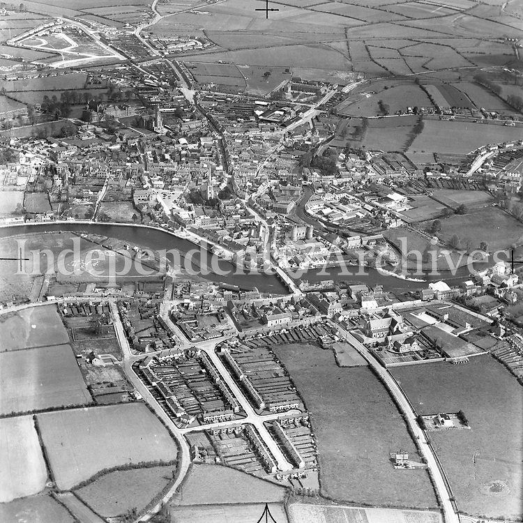 A84 Carlow.   03/09/54. (Part of the Independent Newspapers Ireland/NLI collection.)<br /> <br /> <br /> These aerial views of Ireland from the Morgan Collection were taken during the mid-1950's, comprising medium and low altitude black-and-white birds-eye views of places and events, many of which were commissioned by clients. From 1951 to 1958 a different aerial picture was published each Friday in the Irish Independent in a series called, 'Views from the Air'.<br /> The photographer was Alexander 'Monkey' Campbell Morgan (1919-1958). Born in London and part of the Royal Artillery Air Corps, on leaving the army he started Aerophotos in Ireland. He was killed when, on business, his plane crashed flying from Shannon.
