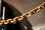 Rusty anchor chain on a fishing boat, Gloucester, Massachusetts