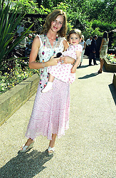 TRINNY WOODALL and her daughter LYLA ELICHAOFF at a children's party to celebrate the launch of the new Baby Dior store in London - held in Eaton Square, London on 8th June 2005.<br />
