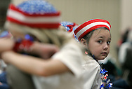 A young girl from the Ruskin Christian School choir peers out during a Veteran's Day ceremony in Sun City Center, Florida, on Nov. 11, 2006. The children sang the songs to all branches of the military - something greatly appreciated by the veterans in attendance.