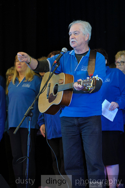 Spirit of the Streets choir performed at the 2018 Guildford Songfest, inside the Guildford Town Hall. Musical Director and Founder of the Spirit Of the Street Choir, Bernard Carney, on stage with the choir at the 2018 Guildford Songfest.