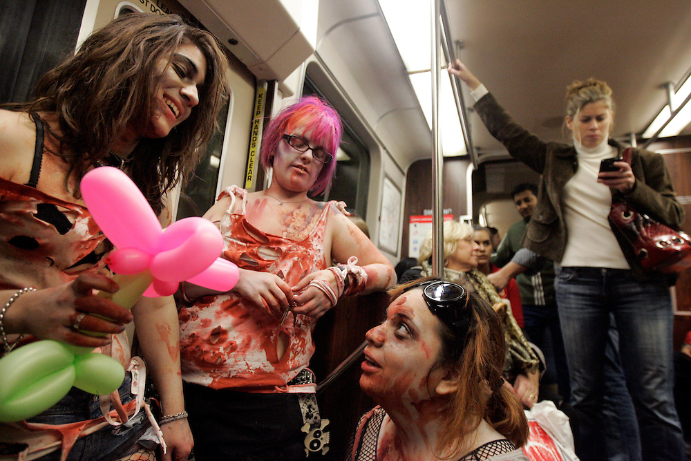 -October 25, Boston, MA-..After walking around Boston in zombie garb for almost four hours as part of the Zombie March on Sunday afternoon, Sophia Goutzinos, left, 19, of Boston, Kelsey Marr, center, 19, of Jamaica Plain and Alexis Lopez, right, 17, of Watertown, MA ride the Green Line home, accompanied by even more confused stares...(Photo by Brooks Canaday)