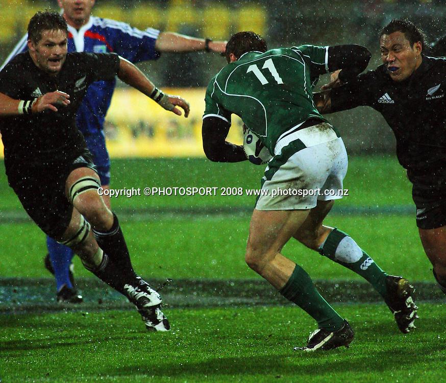 Tommy Bowe beats Anthony Tuitavake as Richie McCaw closes in.<br />International Test Match - All Blacks v Ireland, Westpac Stadium, Wellington. Saturday 7 June 2008. Photo: Dave Lintott/PHOTOSPORT