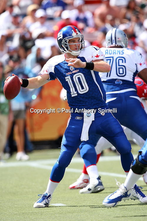 HONOLULU, HI - FEBRUARY 08: NFC All-Stars quarterback Eli Manning #10 of the New York Giants throws a pass against the AFC All-Stars in the 2009 NFL Pro Bowl at Aloha Stadium on February 8, 2009 in Honolulu, Hawaii. The NFC defeated the AFC 30-21. ©Paul Anthony Spinelli *** Local Caption *** Eli Manning