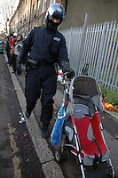 Riot police and Bailifs evicting 21 houses of squatters in St. Agnes Place Kennington South London after 30 years of squatting the street.