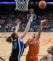 Virginia Cavaliers Guard Sharne? Zoll (5) shoots over Duke Blue Devils Center Alison Bales (43).  The University of Virginia Cavaliers lost to the #1 ranked Duke University Blue Devils 76-61 at the John Paul Jones Arena in Charlottesville, VA on February 2, 2007.