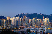 City skyline and north shore mountains at sunset, Vancouver, British Columbia, Canada.