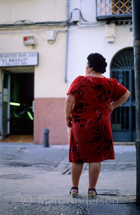 An old Spanish lady wearing a red dress, Jaen, Andalucia, Spain