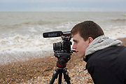 Film students on location at a stormy beach, on 30th April 2017, at Winchelsea, England