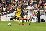 Dean Lewington (3) beats Liam Boyce (27) during the EFL Sky Bet League 1 match between Milton Keynes Dons and Burton Albion at stadium:mk, Milton Keynes, England on 5 October 2019.