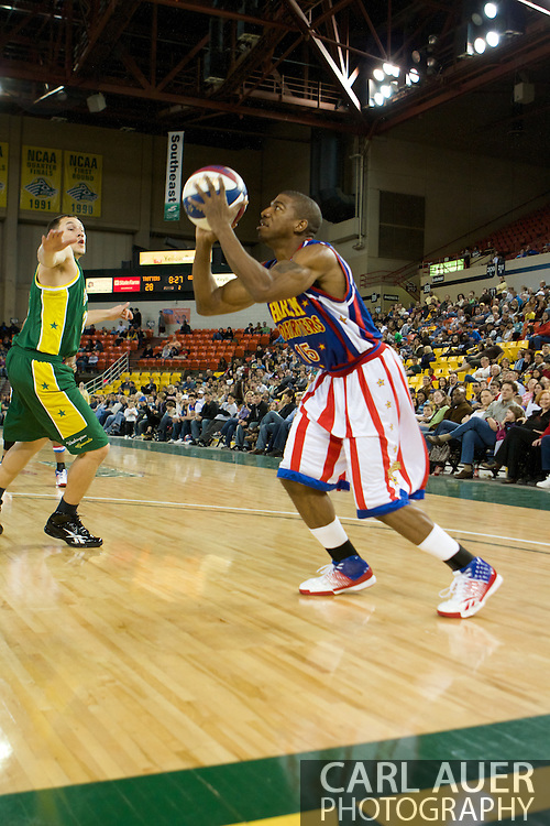 April 30th, 2010 - Anchorage, Alaska:  Dunks and pranks are not the only skills of the Harlem Globetrotters as deminstrated by Buckets Blakes as he squares up baseline for a jump shot.