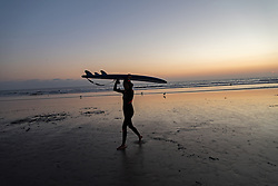 Surfers head back in after catching some waves  in Venice Beach, California October 9, 2014. (Photo by Ami Vitale)
