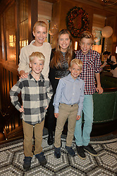VISCOUNTESS HINCHINGBROOKE and her children EMMA FISHER, JACK FISHER, the HON.WILLIAM MONTAGU (Black & white shirt) & the HON.NESTOR MONTAGU (blue shirt) at a party hosted by Camila Batmanghelidjh for Kids Company held at The Ivy Market Grill, 1 Henrietta Street, Covent Garden, London on 23rd November 2014.