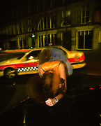 Police car pulling up to deal with a drunk couple on the streets of Newcastle, 1999