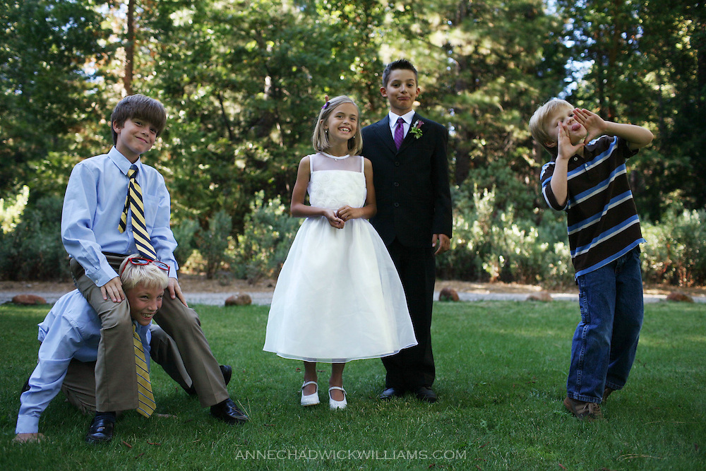 Children play around before a wedding in Foresthill, CA.
