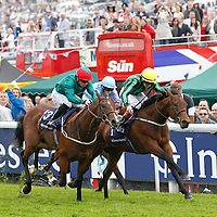 Chilworth Lad (yellow cap) and Martin Harley winning the Investec Woodcote Stakes