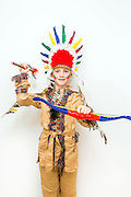 Young boy of 8 dressed uo as a red Indian on white background