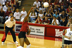 Stanford's Ogonna NNamani returns the ball during a fierce volley. The game and set was won by Stanford.  The match up took place at ISU's Redbird Arena in Normal Illinois on September 11, 2002.  The crowd was over 5600 and took the record for fans attending a volleyball game at Redbird, the MVC's record for number of fans watching a conference team and was the largest audience in the continental US thus far in the 2002 season<br />