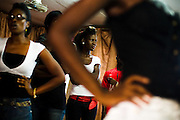 Nana Yaa Adadewa Addo, 24, waits in line with other models during a rehearsal where models come to practice their catwalk in Ghana's capital Accra on Thursday May 21, 2009. Nana Yaa is one of several Ghanaian girls who auditioned for the upcoming television show West Africa's Next Top Model, the latest incarnation of Tyra Banks' America's Next Top Model.