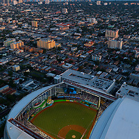 Aerial of the new Miami Marlins baseball stadium park glows with downtown Miami in the background. Aerial of the new Miami Marlins baseball stadium park glows with downtown Miami in the background suitable for a framed poster print.