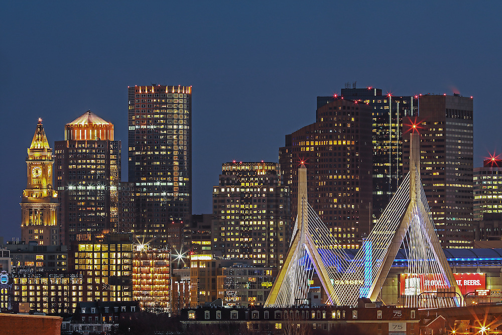 Boston skyline picture showing landmarks such as the Custom House of Boston, Leonard P. Zakim Bunker Hill Memorial Bridge, One International Place and the TD Bank North Garden photographed on a stunning night at twilight. This Boston skyline photography image is available as museum quality photography prints, canvas prints, acrylic prints or metal prints. Fine art prints may be framed and matted to the individual liking and decorating needs: <br />