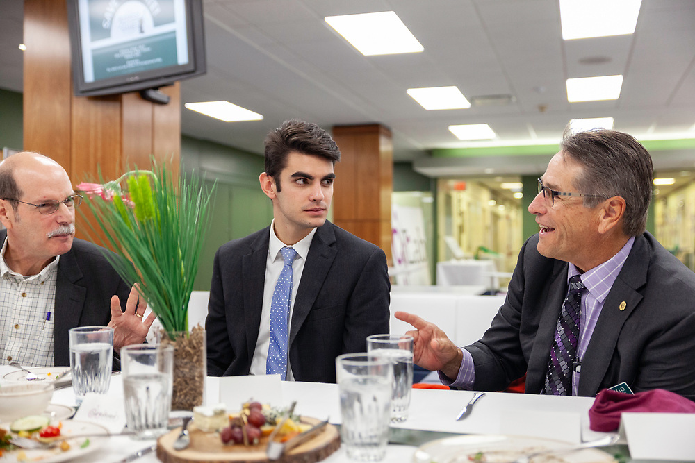 Mark Weinberg, dean of the George V. Voinovich School of Leadership and Public Affairs; Austin McClain, a student trustee on the Board of Trustees and junior in business economics; and Dave Scholl, Board of Trustees chair, enjoy lunch and conversation at the grand opening and ribbon cutting for the new CoLab, October 18, 2018. (Photo by Stephen Zenner/Ohio University Libraries)