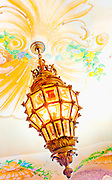An ornate chandelier hangs from the painted ceiling in the dining room of the former Versace mansion, now a boutique hotel, the Casa Casuarina, on Miami's Beach's Ocean Drive