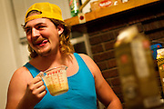 Jake McVeigh '11 licks his lips while holding his first of many pints of egg nog during Monday night's attempt to drink an entire gallon of egg nog at Entropy House.