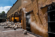 Steam escaping door of stone oven used to cook agave plants for 36 hours, Tequlia, Mexico