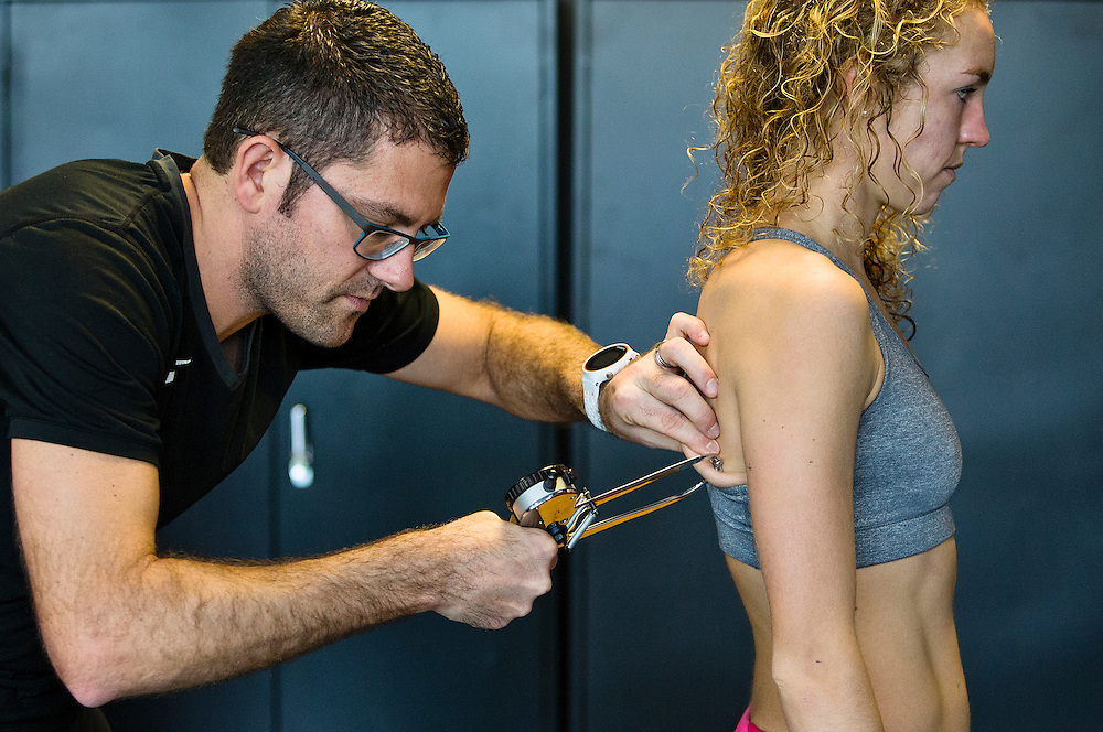 Trent Stellingwerff, applied sport physiologist with a specialization in performance nutrition performs anthropometric measurements on Jessica Furlan at the Pacific Institute for Sport Excellence on December 3rd 2015 in Victoria, British Columbia Canada.