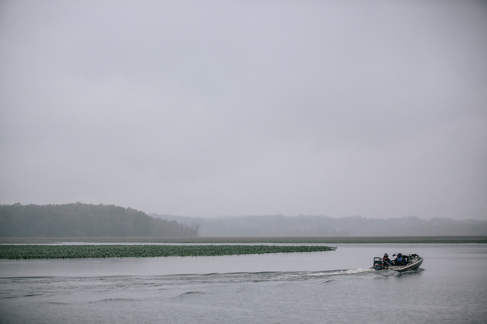 Teams brave the wet weather to fish for bass during the FLW College Fishing Northern Conference Invitational in Marbury, MD on Oct. 11, 2014. Only the top 15 of 43 teams moved on to Sunday.