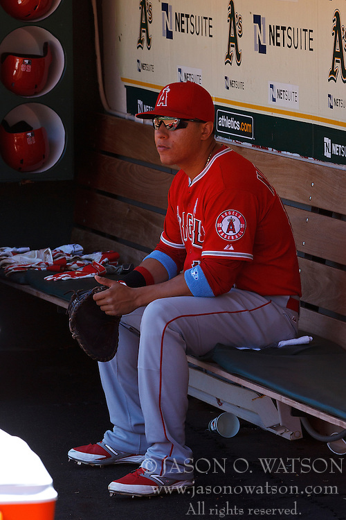 OAKLAND, CA - JUNE 21:  Efren Navarro #19 of the Los Angeles Angels of Anaheim sits in the dugout before the game against the Oakland Athletics at O.co Coliseum on June 21, 2015 in Oakland, California. The Oakland Athletics defeated the Los Angeles Angels of Anaheim 3-2. (Photo by Jason O. Watson/Getty Images) *** Local Caption *** Efren Navarro