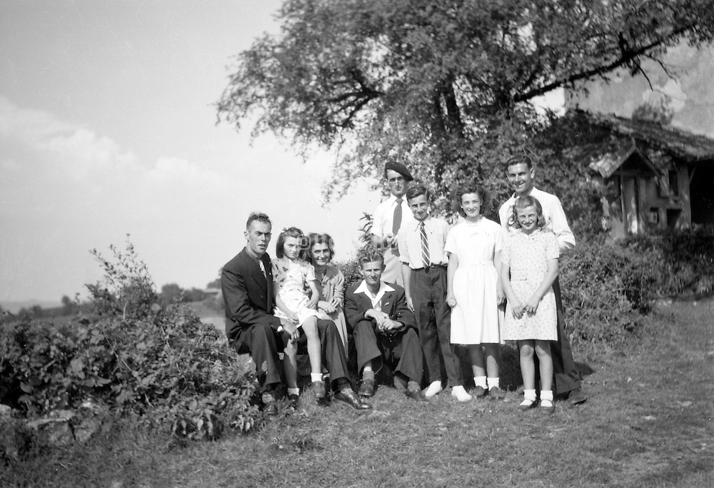 large family posing in rural landscape