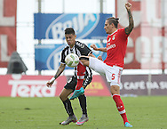Nacional´s player Willyan (L ) fights for the ball with Benfica's player Fejsa   (R ) during Portuguese First League football match Nacional vs Benfica  held at Madeira Stadium, Funchal, 11 January 2016.  LUSA / GREGORIO CUNHA